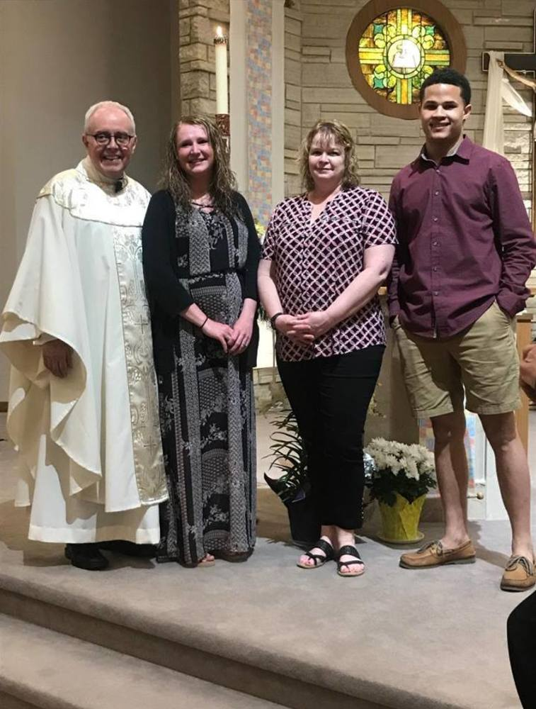 Pictured Fr. John Haugen, Bridget Dugan, Mary Brown, and Walter Ollie all joined the Catholic Church at the Easter Vigil 2019.