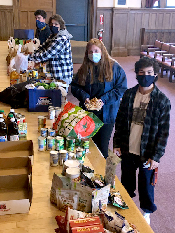 Students packing cans from the Thanksgiving Food Drive - to be donated to the Spanish American Center in Leominster, MA