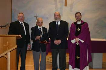 Abare Honored for 80 years as a Knight