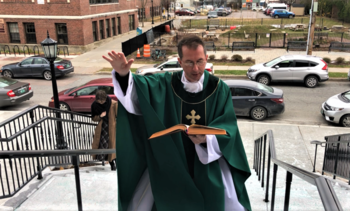Blessing the rebuilt stairs and steeple
