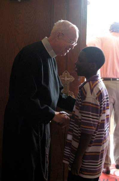 Br. Patrick doing what he use to always do, greeting parishioners after all the Sunday Masses.  A great example for us all.