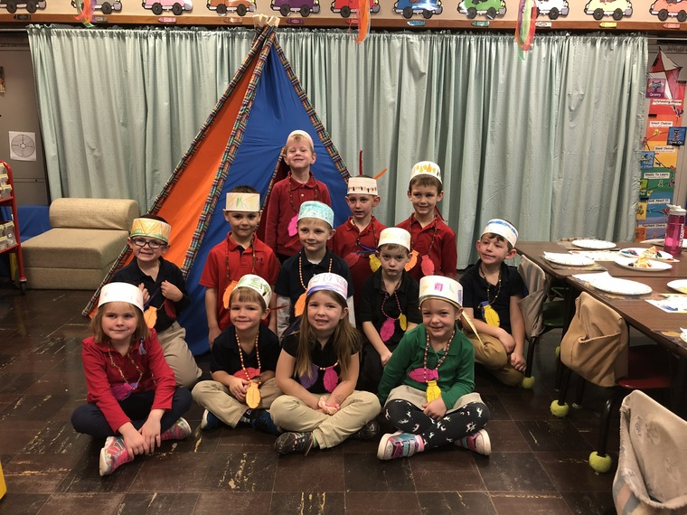 kindergarten students in front of classroom teepee