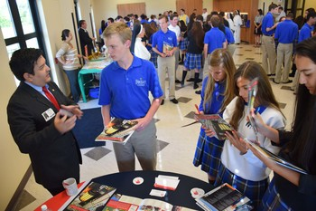 College representatives visit with students