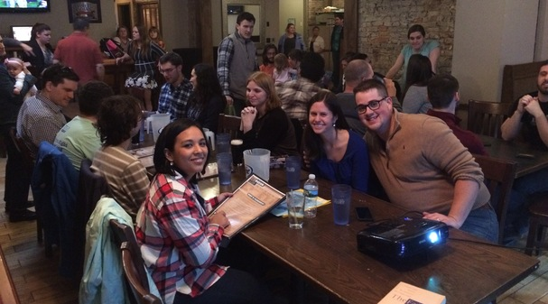 Participants gathered at a Theology on Tap event