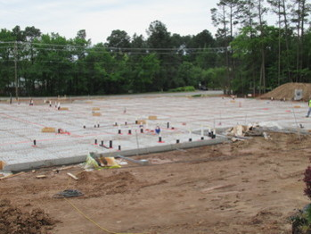 Workers poured foundation for the new church this week