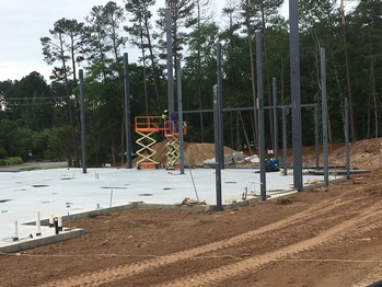 Building update: Steel girders rise from poured foundation this week