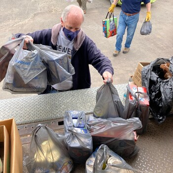 Parish donates nearly a ton of food to Drive-By Food Drive