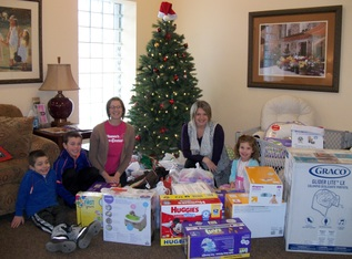 Crib Club Gifts Delivered to Women's Care Center