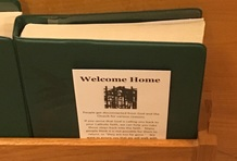 Welcome home card in pew