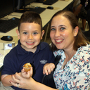 Students enjoy a meal with parents at Scholastic Book Fair