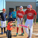 IWA Varsity Baseball Team plays ball with special-needs children