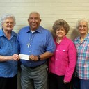 KJT awards check to OLPH CCD program