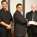 Bishop Mulvey presents check to diocesan priests from Kerala, India