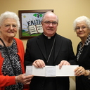 KJT present checks to Bishop Mulvey
