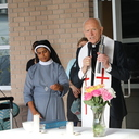 Bishop Emeritus Carmody blesses new covered pavilion at the Mother Teresa Day Shelter