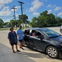 St. Pius X holds a drive-thru meet and greet and provide parents needed supplies