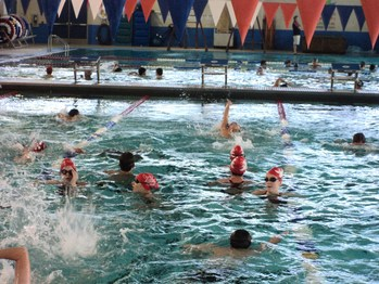 Angels compete in first  <div>  swim meet of the season </div>