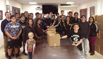 Students help Catholic Charities package gifts for less fortunate in Sarita