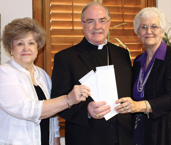KJT presents checks to Bishop Mulvey