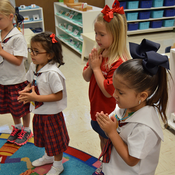 Students begin school day with a prayer