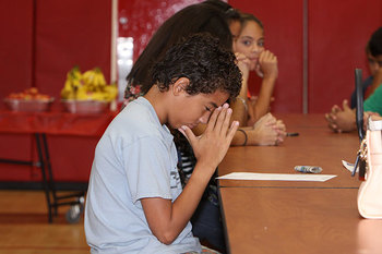 Athletes kick off school year with prayer and breakfast