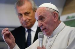 Meeting reporters on plane, pope defends his teaching  <div>  on social issues </div>