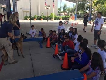 Corpus Christi ISD police officers visit Holy Family School during Red Ribbon Week