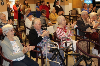 Students bring Christmas cheer to residents at Assisted Living Home