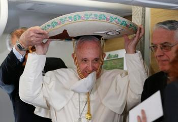 Cookies, sombrero and a shoe shine: reporters give pope gifts