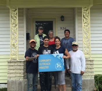 OLPH volunteers paint a home