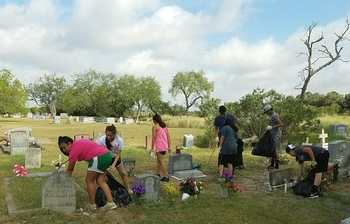 Year of Mercy Project: Banquete youth clean local cemetery