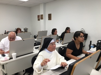 Catholic school administrators participate in school management systems training