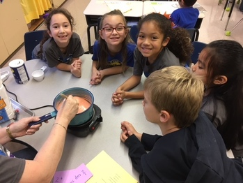 Students make dough as part of reading exercise