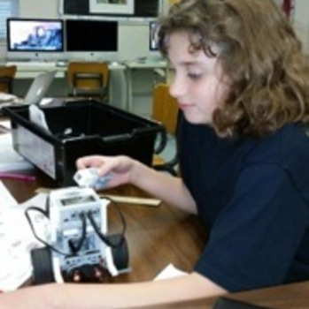 Students working with robotics and coding