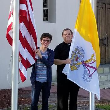 Boy Scout donates flag pole, flags to Holy Family