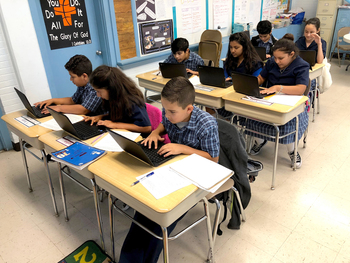 Ss.Cyril & Methodius Fifth-grade students use Chromebooks