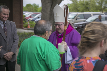 Bishop Mulvey celebrates with St. Patrick Mission