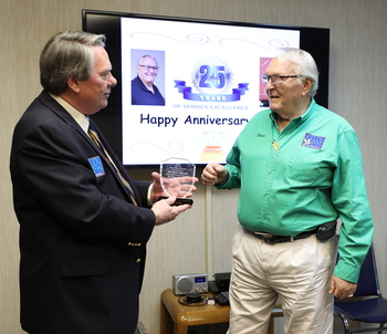 Russ Martin receives an award for '25 years of Excellence'