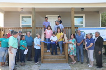 Catholic Charities, volunteers and local businesses help the Peña family get a new home