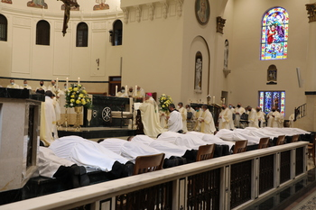 Thirteen men were ordained to the permanent diaconate