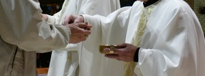 Distribution of Communion at Mass as of January 2021 has returned to after Consercration.