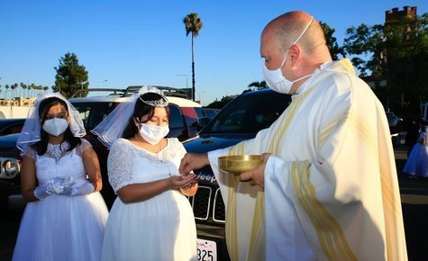 Amid latest COVID restrictions, LA churches take the sacraments outside