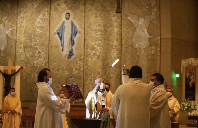 'This Easter, our Lord is calling us back,' Archbishop Gomez says in vigil homily