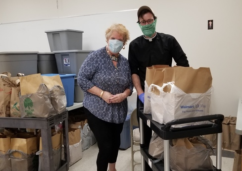 Mary Louise and Conor Working at the Food Pantry