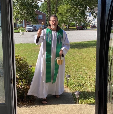 Fr Remo blessing OLA doorway