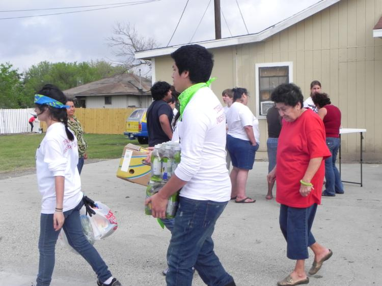 The teens assisted with food distribution to the residents