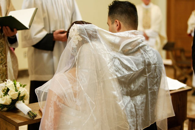 Sacrament of Marriage - Spouses kneeling before altar