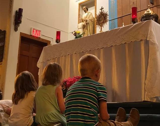 Children in adoration of the blessed sacrament