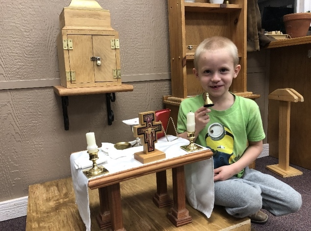 Boy with miniature altar