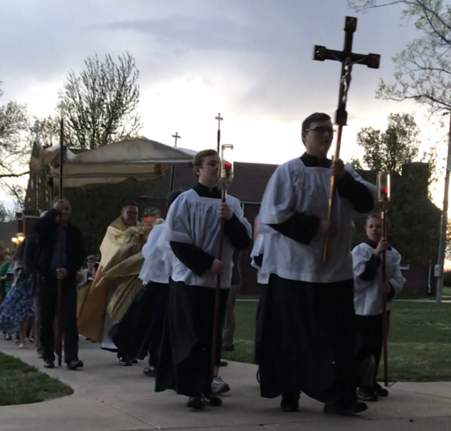 procession with altar servers and a monstrance